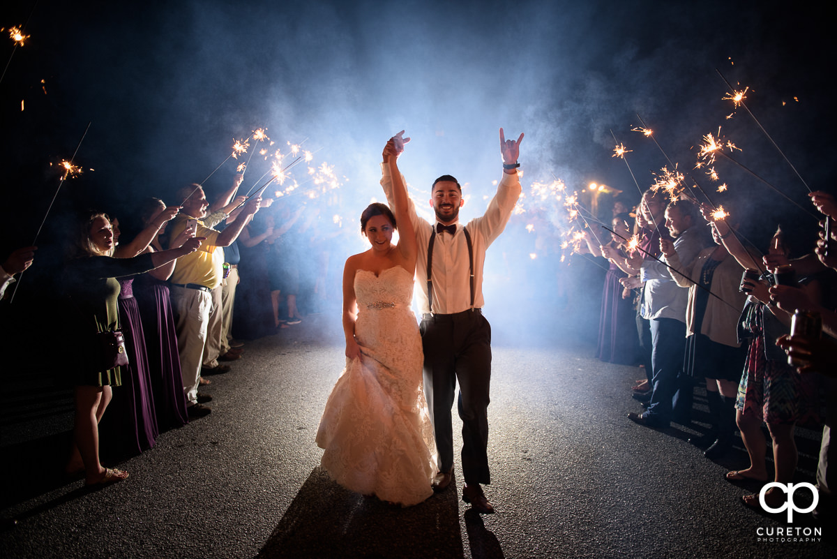 Bride and groom making a grand sparkler exit at Lindsey Plantation.