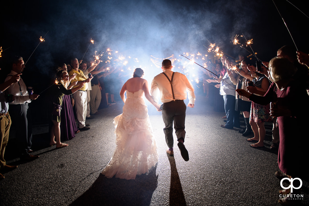 Bride and groom sparkler exit at the Lindsey Plantation wedding reception.