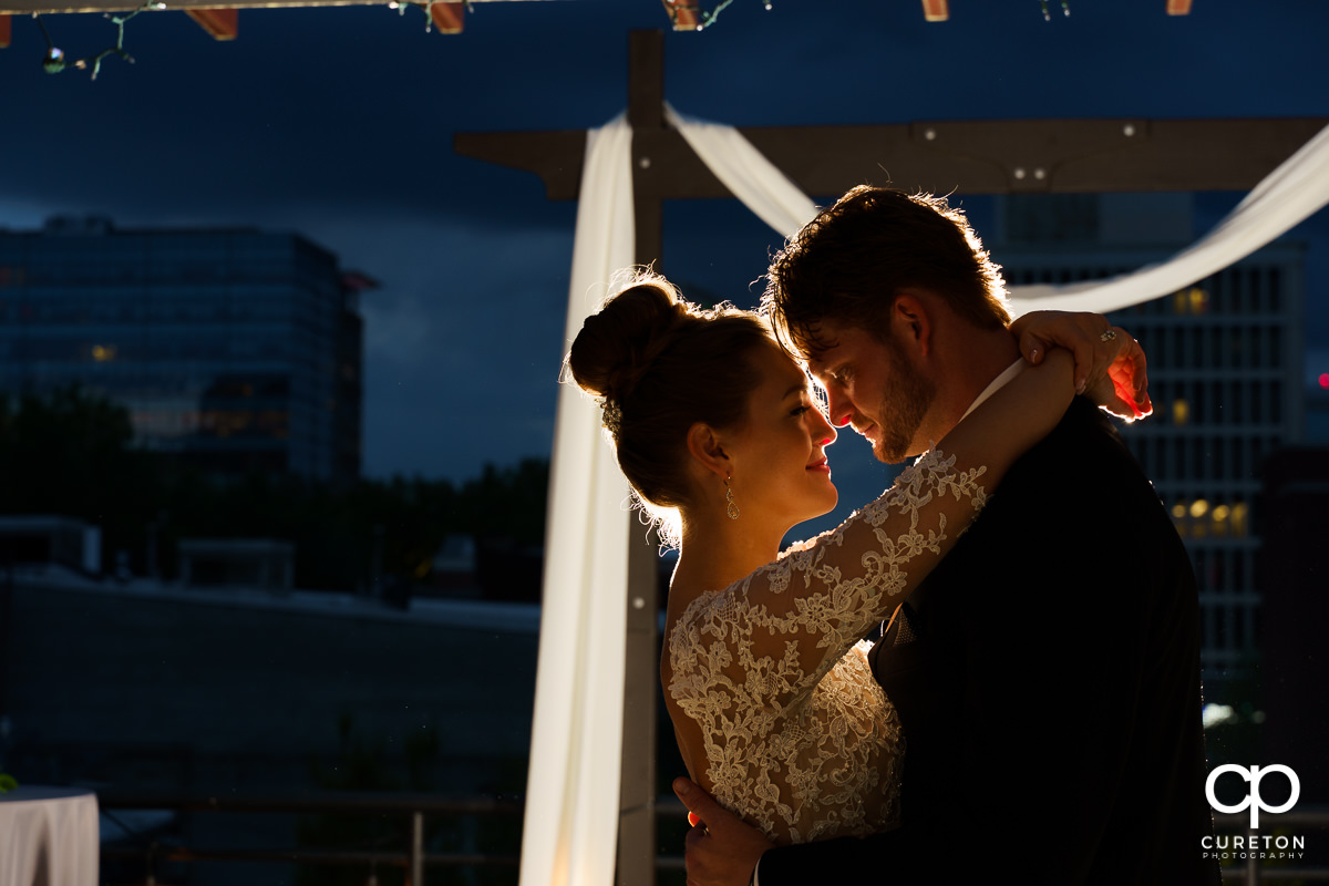 Bride and groom dancing with the skyline in the background after their Loft at Soby's wedding in downtown Greenville,SC.