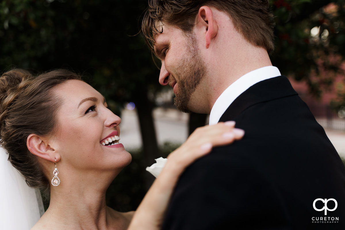 Bride smiling at her husband.