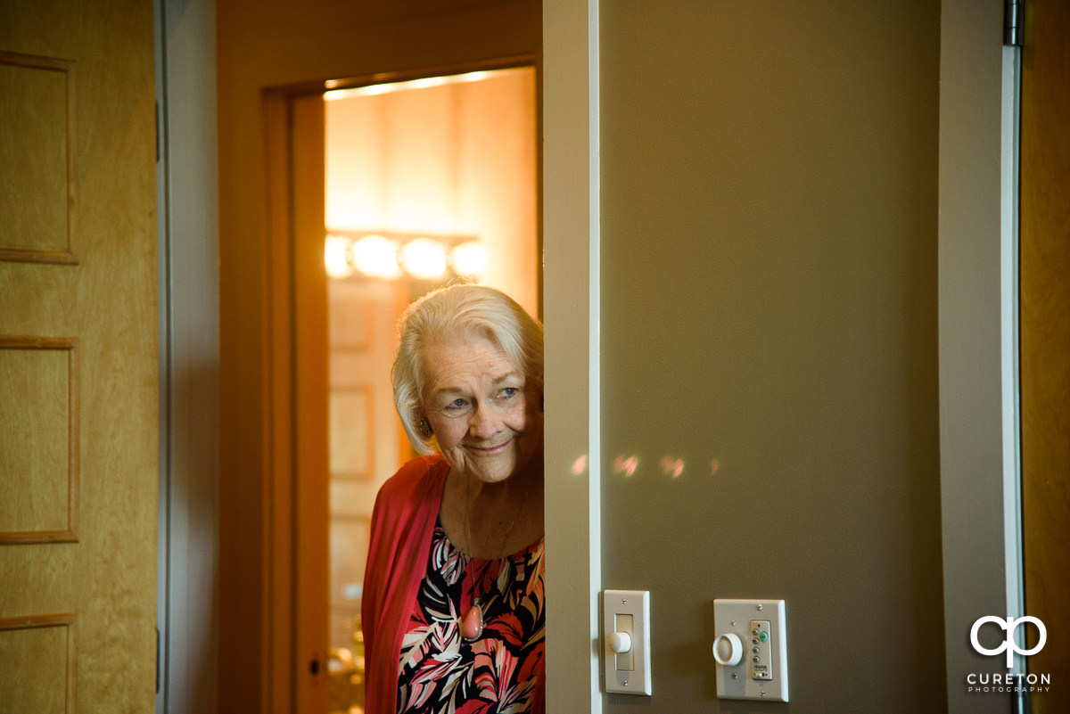 Bride's grandmother watching her get ready for her wedding.