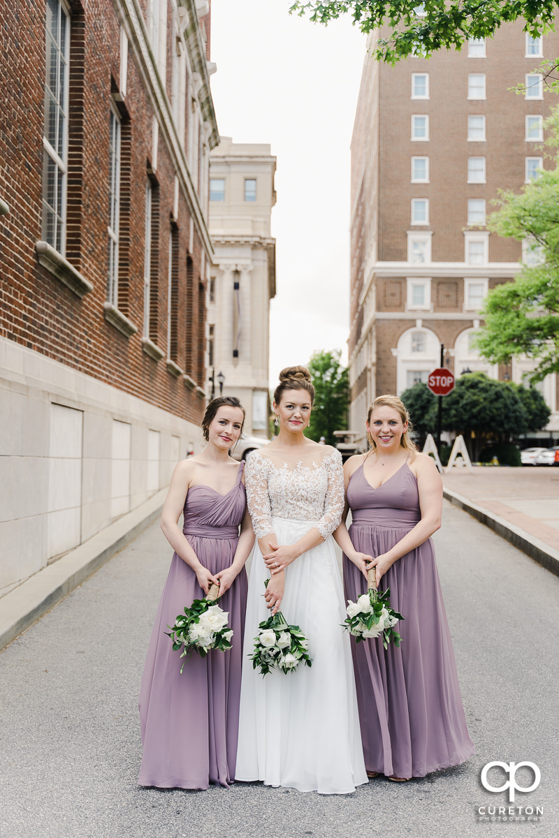 Bride hanging out with her bridesmaids.