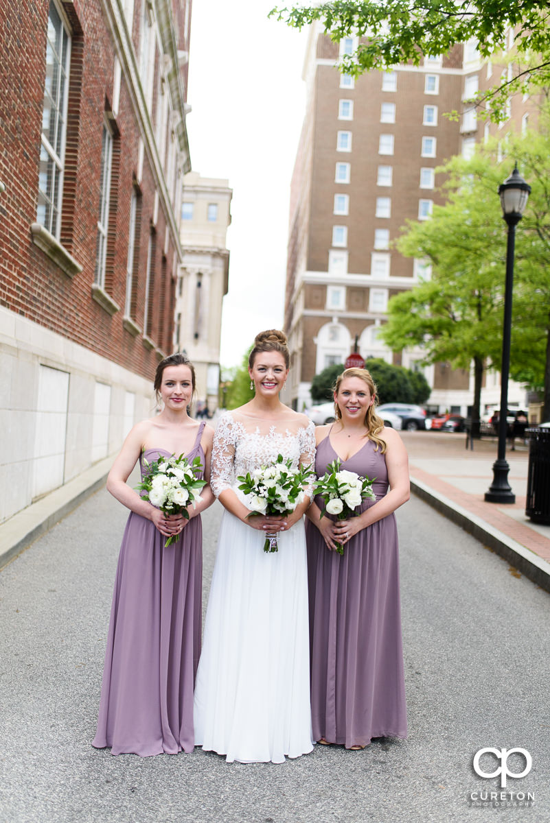 Bride and her bridesmaids hanging out in downtown Greenville before the wedding ceremony.