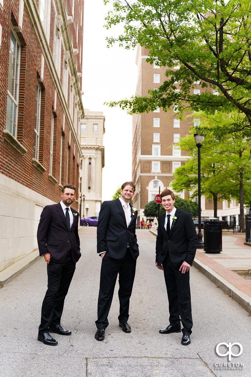Groom and groomsmen standing on Main Street.