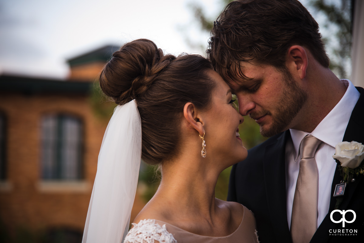 Bride and groom getting close after their Loft at Soby's wedding in downtown Greenville,SC.