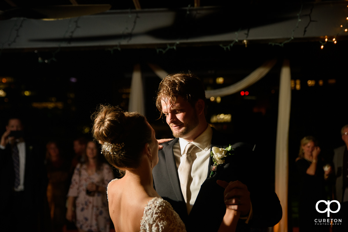 Groom gazing at his bride during their first dance at their Loft at Soby's wedding reception in downtown Greenville,SC.