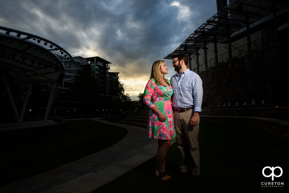 Bride and groom at sunset in downtown Greenville.
