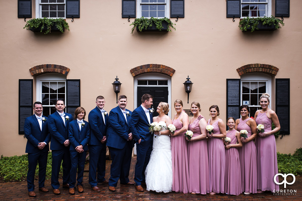 Wedding party in front of the house before their Mary's at Falls Cottage wedding in downtown Greenville,SC.