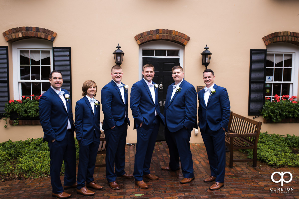 Groom and groomsmen in front of the house before their Mary's at Falls Cottage wedding in downtown Greenville,SC.