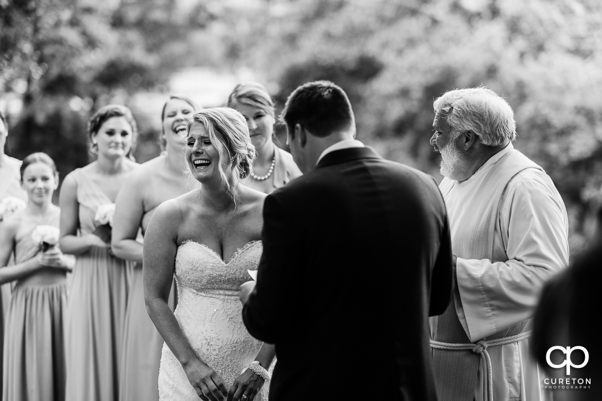 Bride laughing during the wedding ceremony.