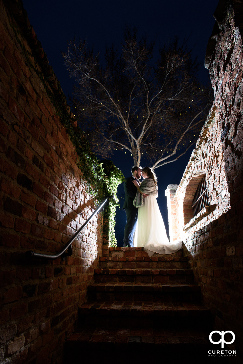 Bride and groom at twilight after their wedding at The Old Cigar Warehouse on New Years Eve.