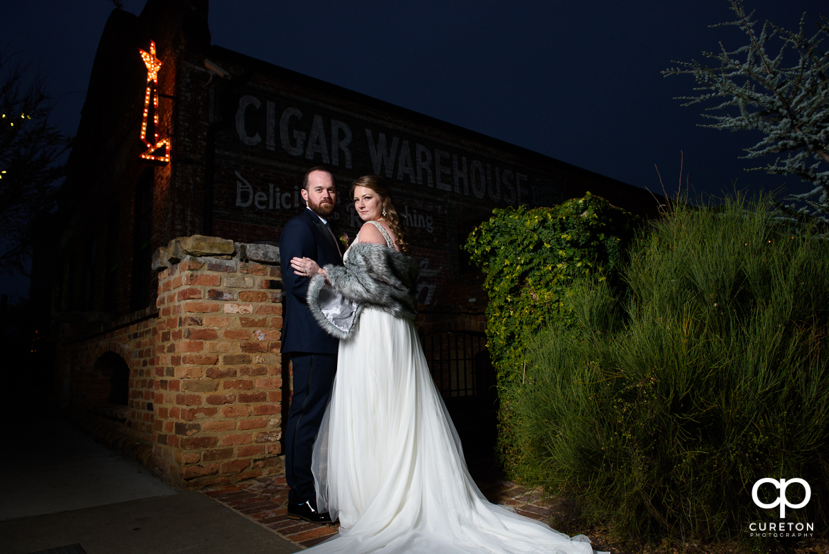 Married couple standing onutside of Teh Old Cigar Warehouse in downtown Greenville,SC.