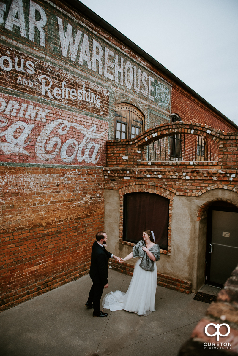 Bride and groom dancing outside of the Old Cigar Warehouse after their wedding.