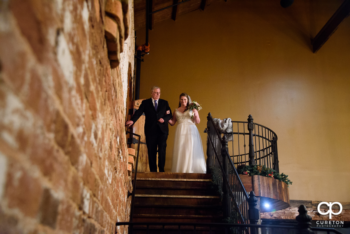 Bride and her dad making a grand entrance down the staircase.
