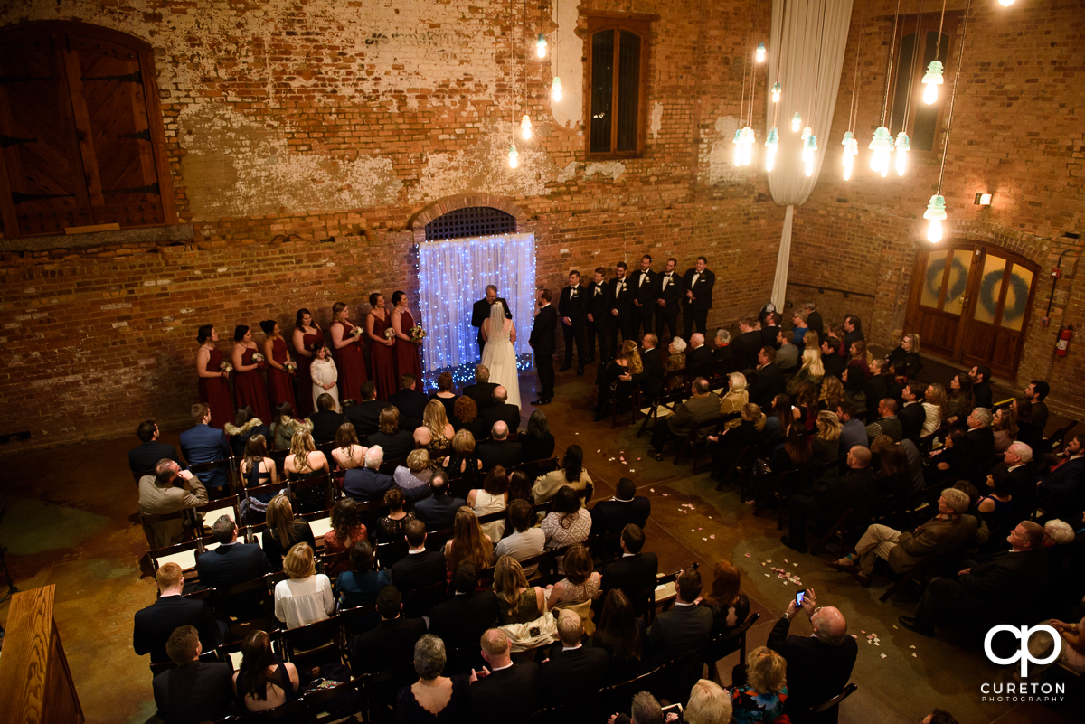 Panoramic shot of a wedding ceremony at the old cigar warehouse in downtown Greenville South Carolina.