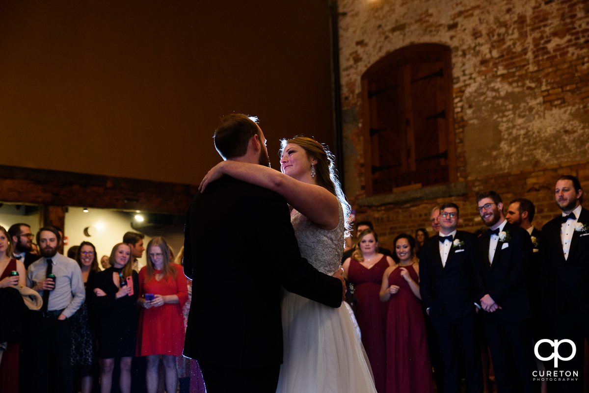 Bride and groom first dance at the old cigar warehouse in downtown Greenville.