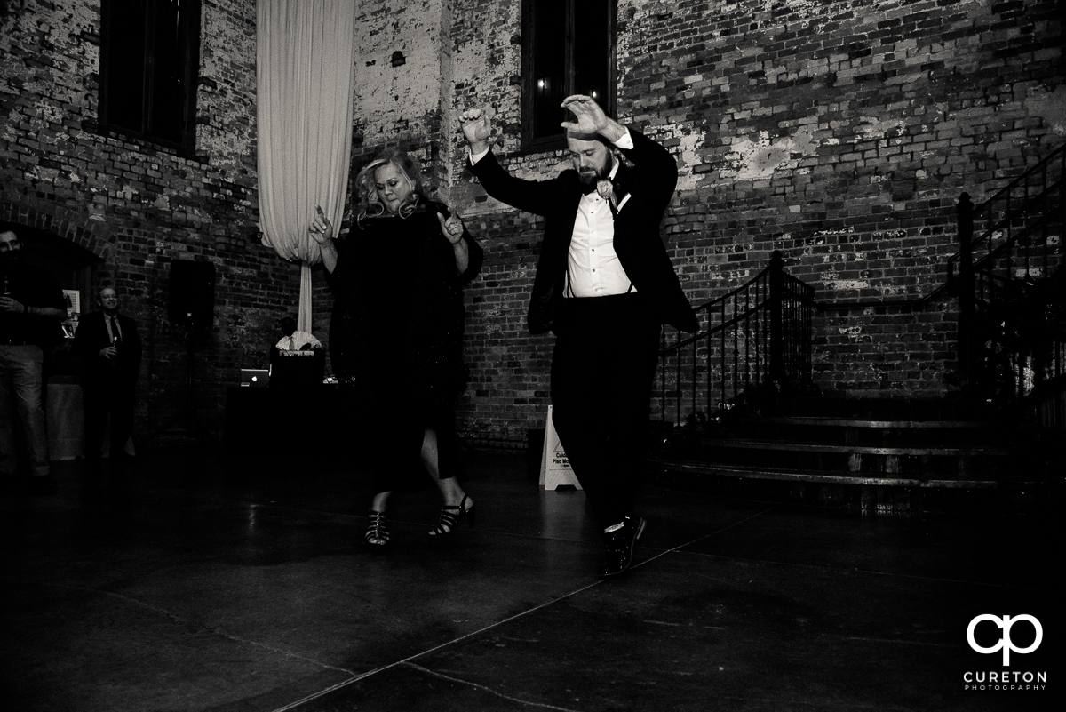 Groom and his mom performing a cool dance at the reception.