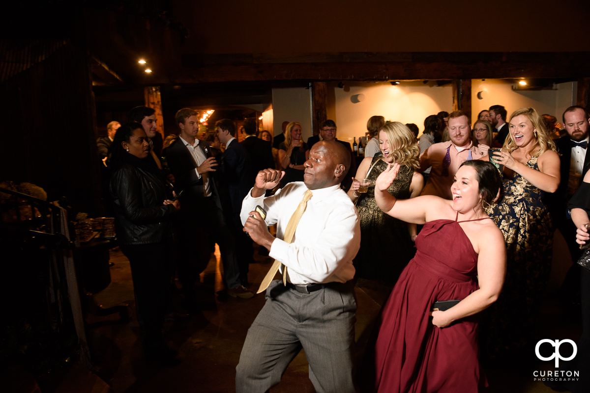 Wedding guests dancing at The Old Cigar Warehouse.