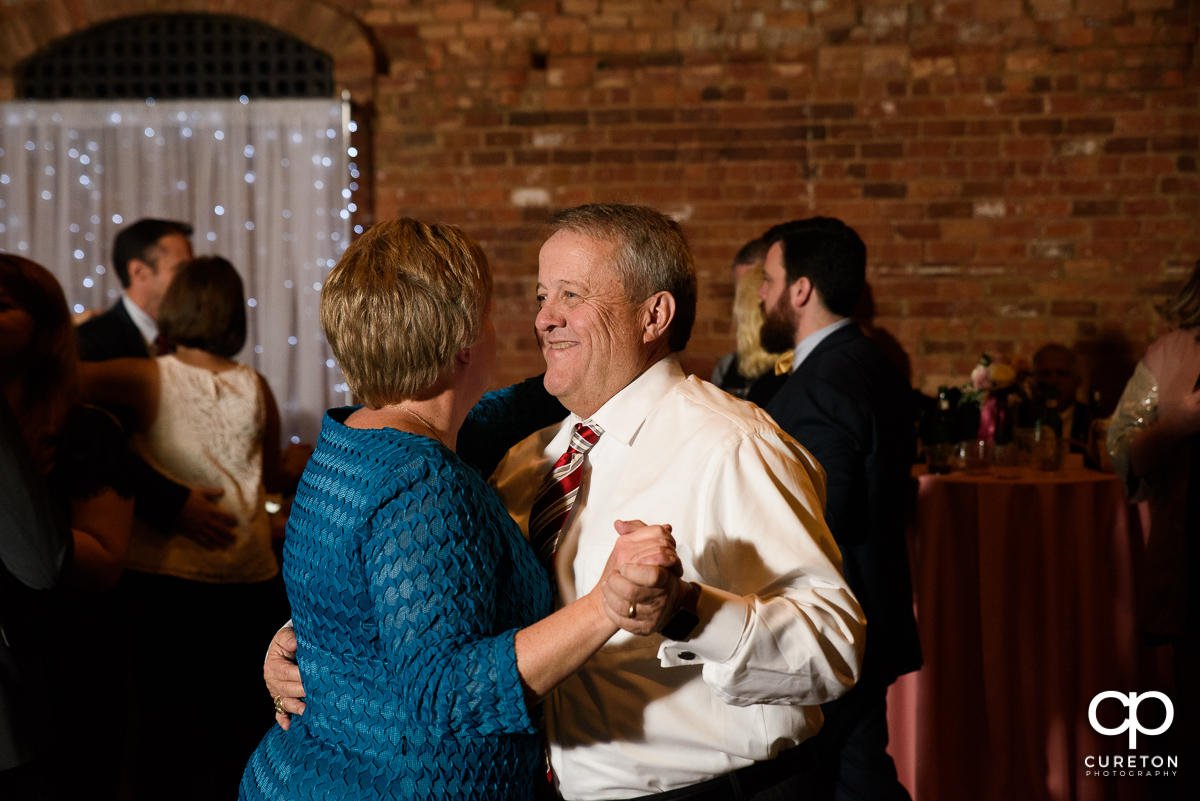 Wedding guest dancing at The Old Cigar Warehouse.