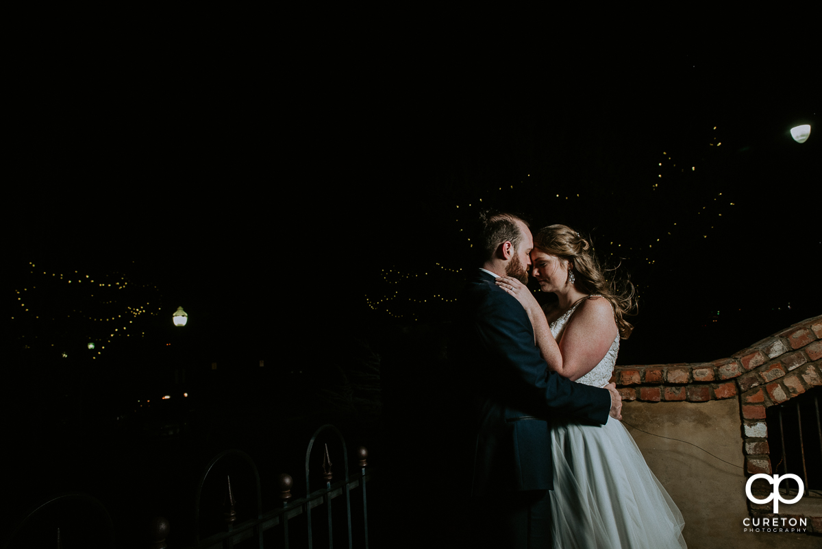 Bride and groom outside after dark at the Old Cigar Warehouse.