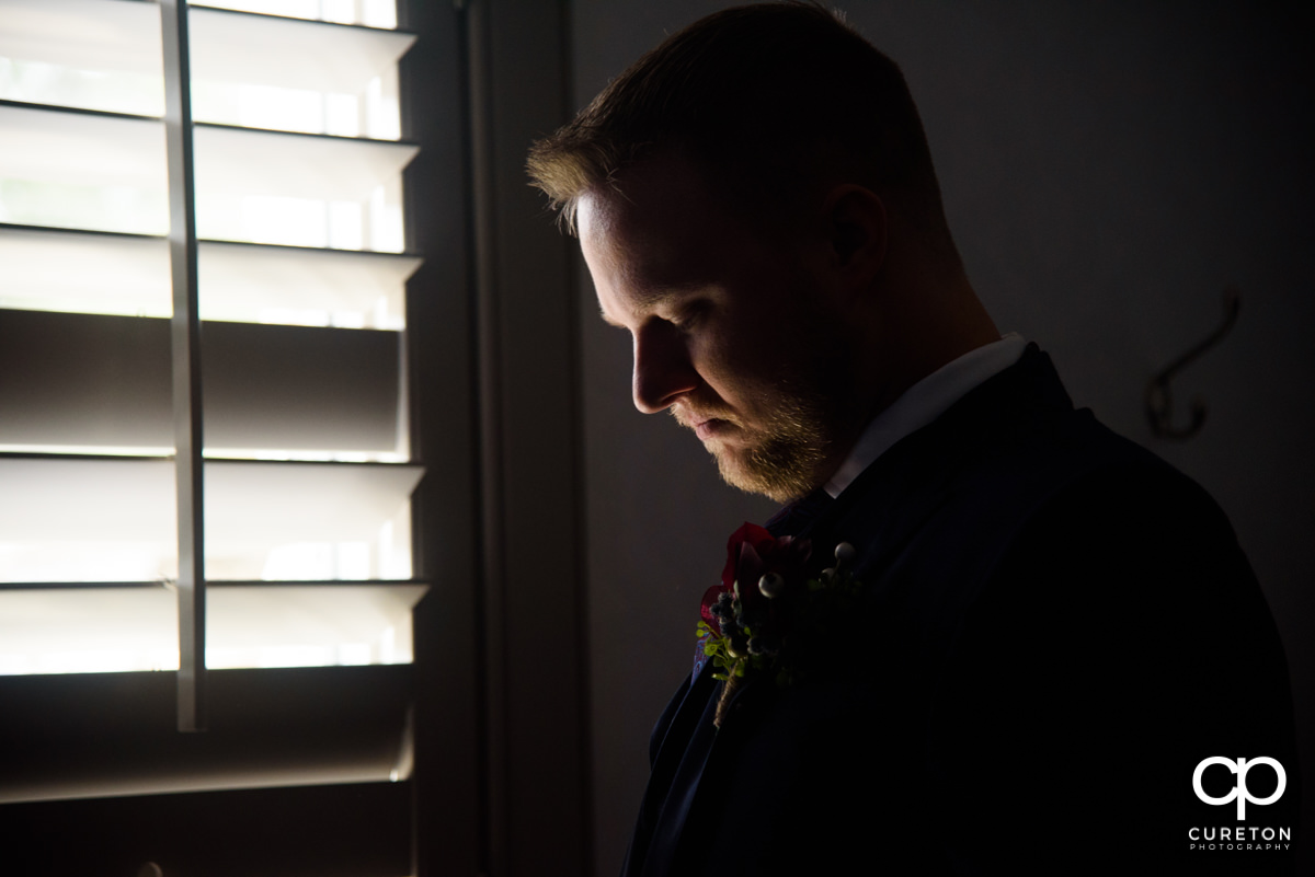 Groom getting ready for his wedding ceremony.