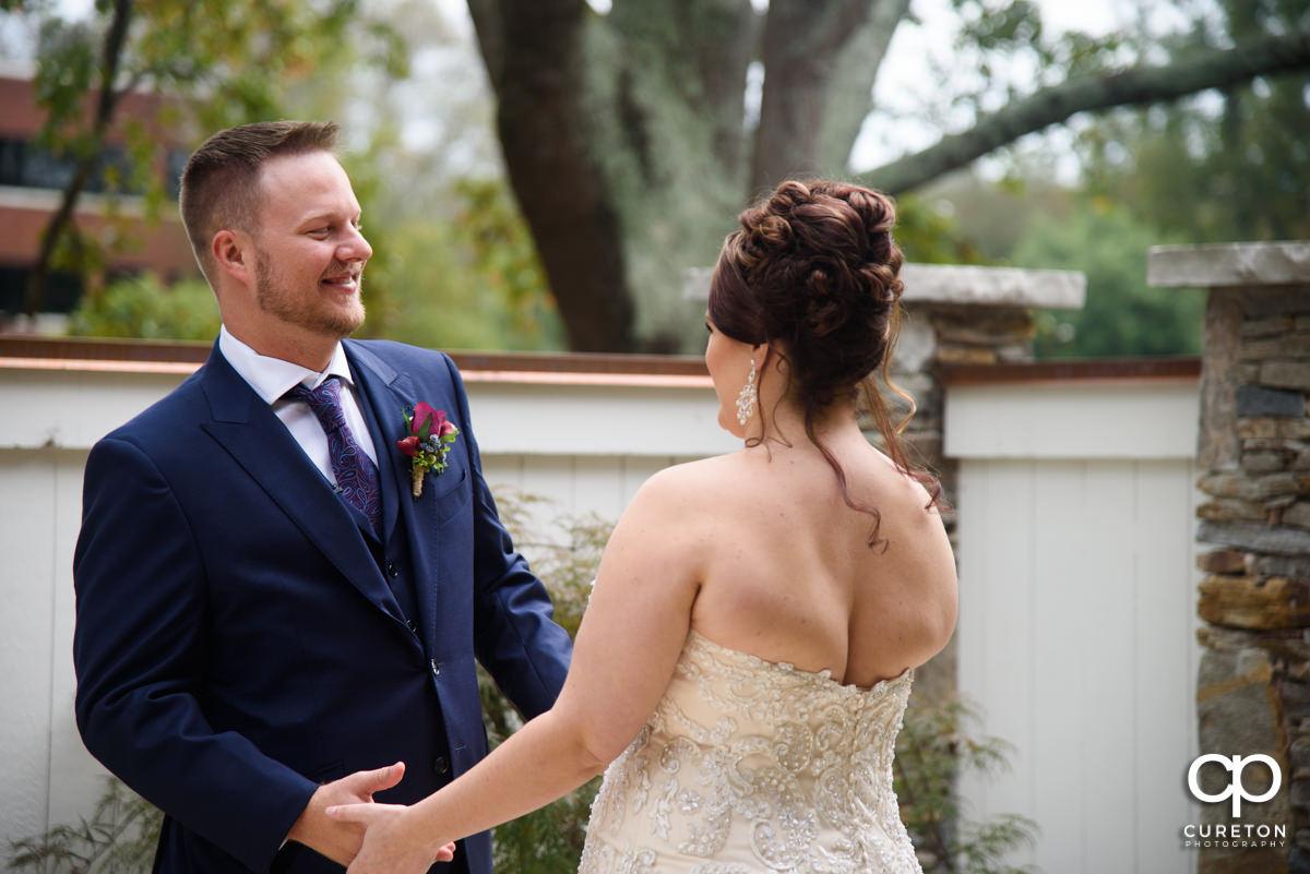 Groom seeing his bride before the wedding.