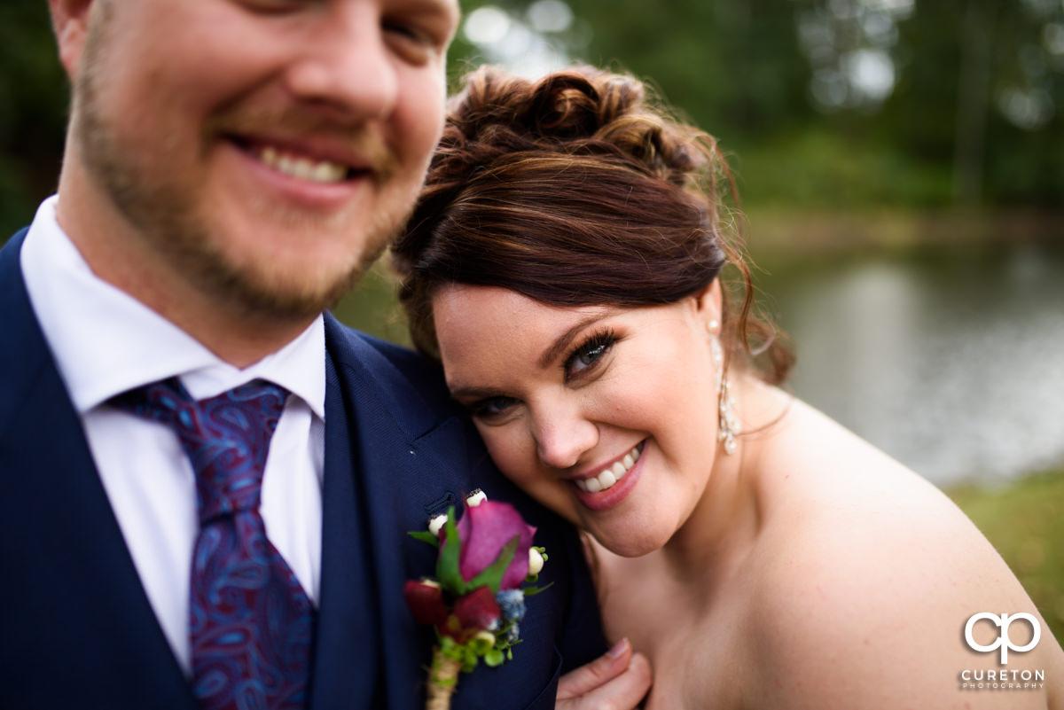 Bride holding onto her groom.