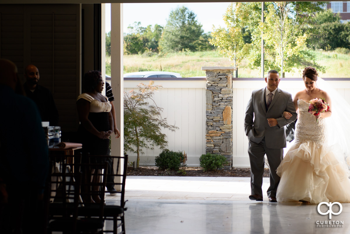 Bride making her entrance into Noah's Event Venue in Mauldin,SC.