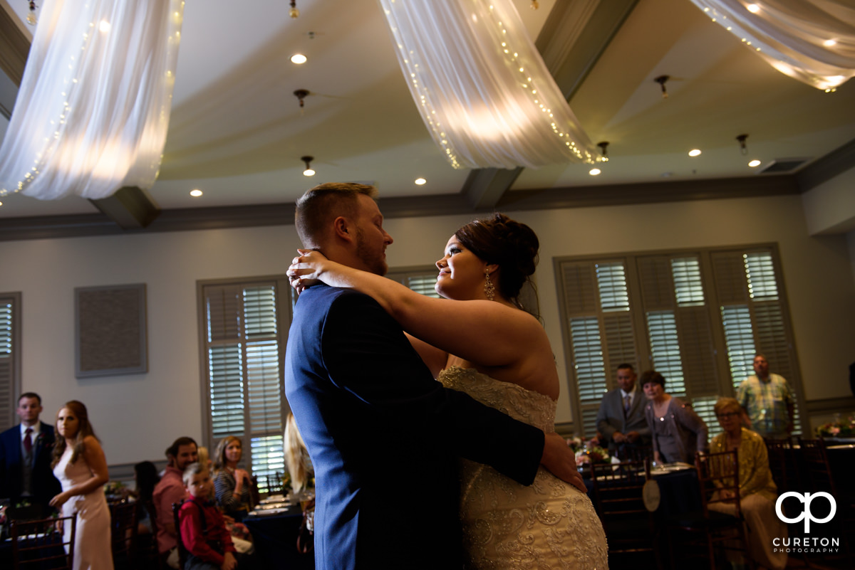 Bride and groom sharing a first dance at their wedding at Noah's Event Venue in Mauldin,SC.