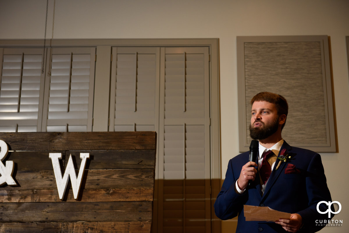 Best man giving a speech.