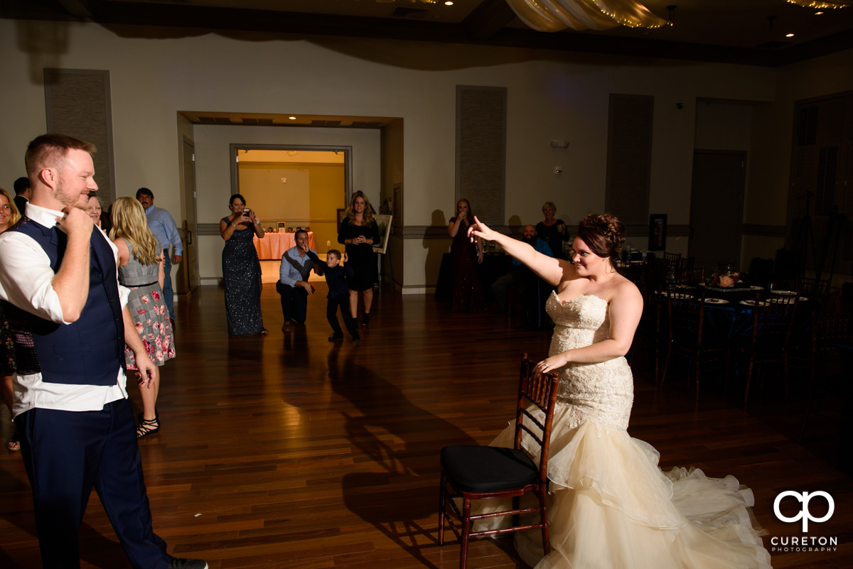 Groom preparing to take off the bride's garter.