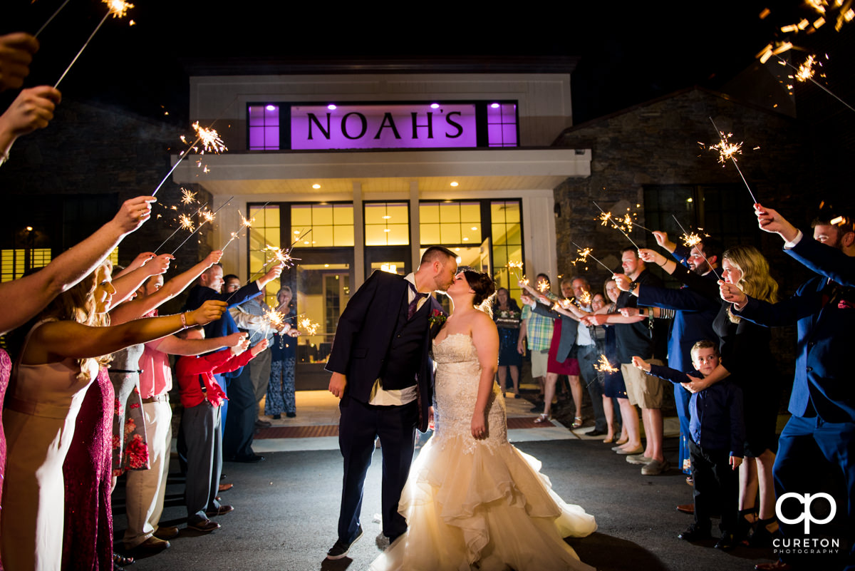 Bride and groom making a grand exit from their reception at Noahs's Wedding Venue in Mauldin,Sc.
