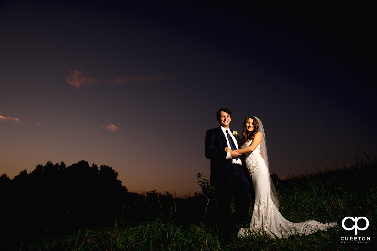 Bride and groom at sunset after their wedding at Noah's Event Venue in Greenville,SC..