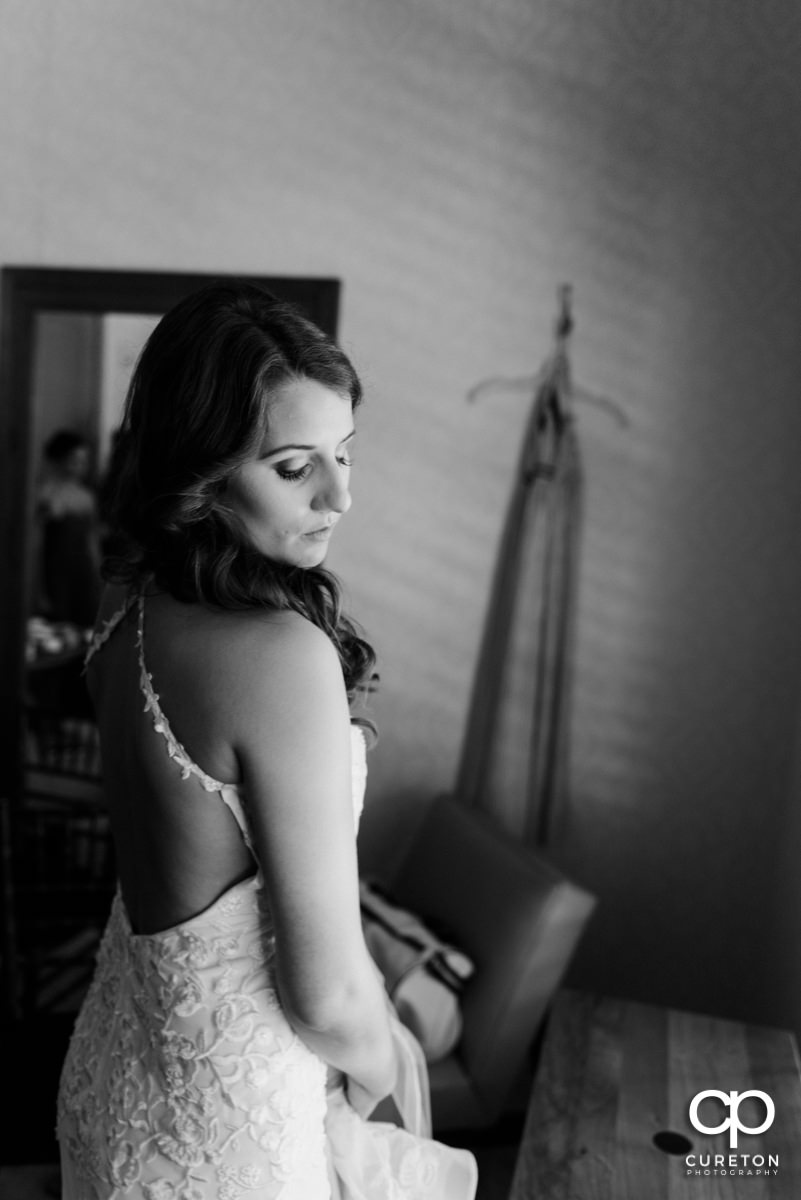 Bride getting ready in the bridal suite.