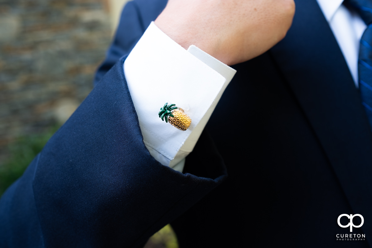 Groom's pineapple cufflinks.