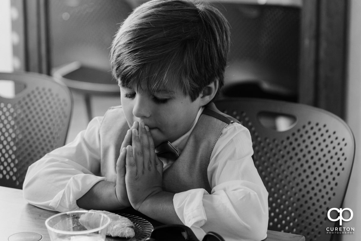 Ring bearer praying.
