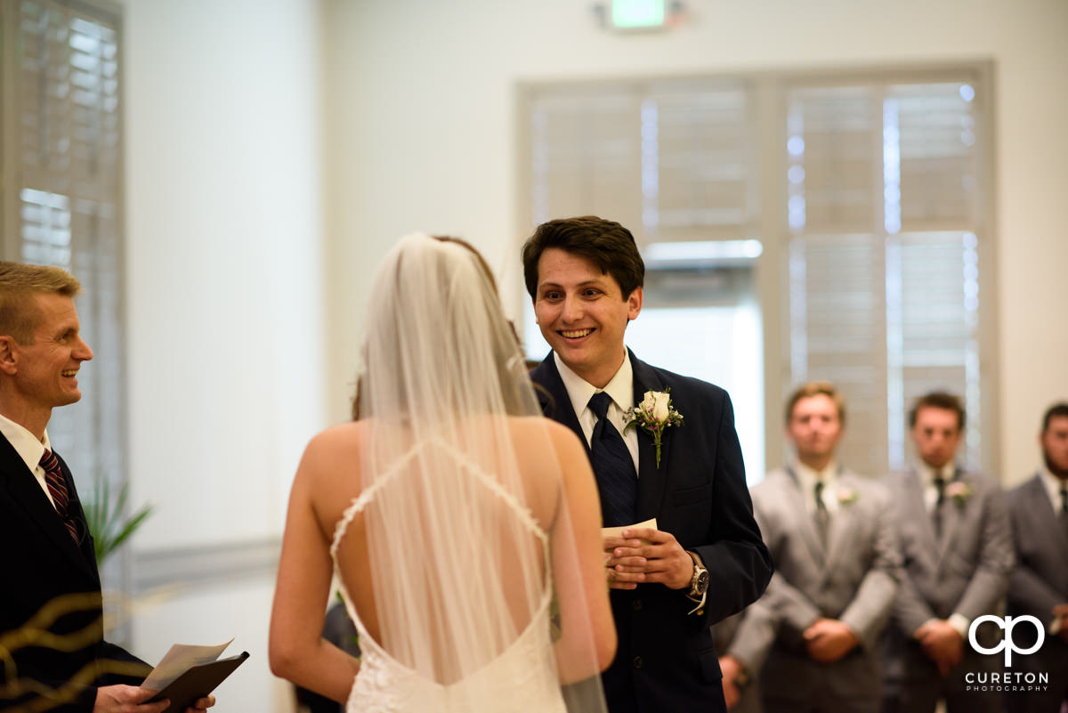 Groom smiling during the wedding ceremony.
