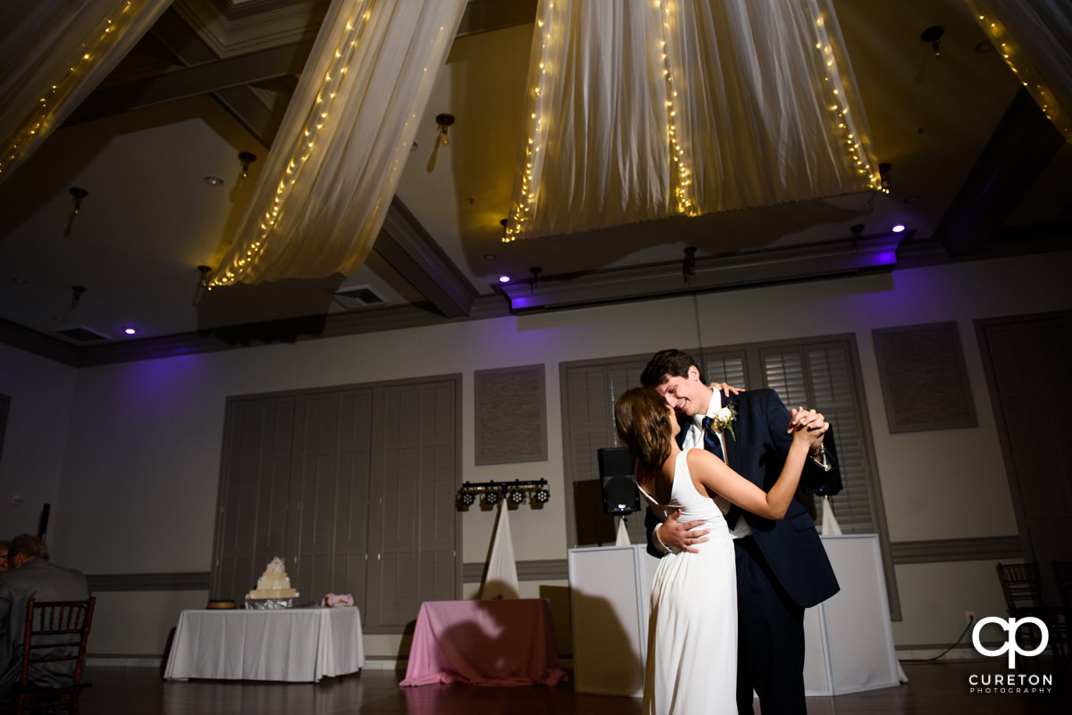 Bride and groom sharing a first dance at their wedding reception at Noah's Event Venue in Greenville.SC.