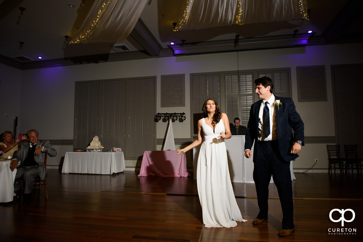 Bride and groom change up their first dance.