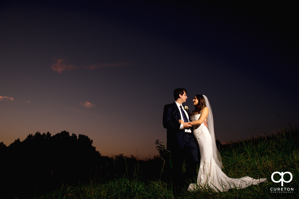 Bride and groom at sunset at their Noah's event venue wedding in Greenville,SC.