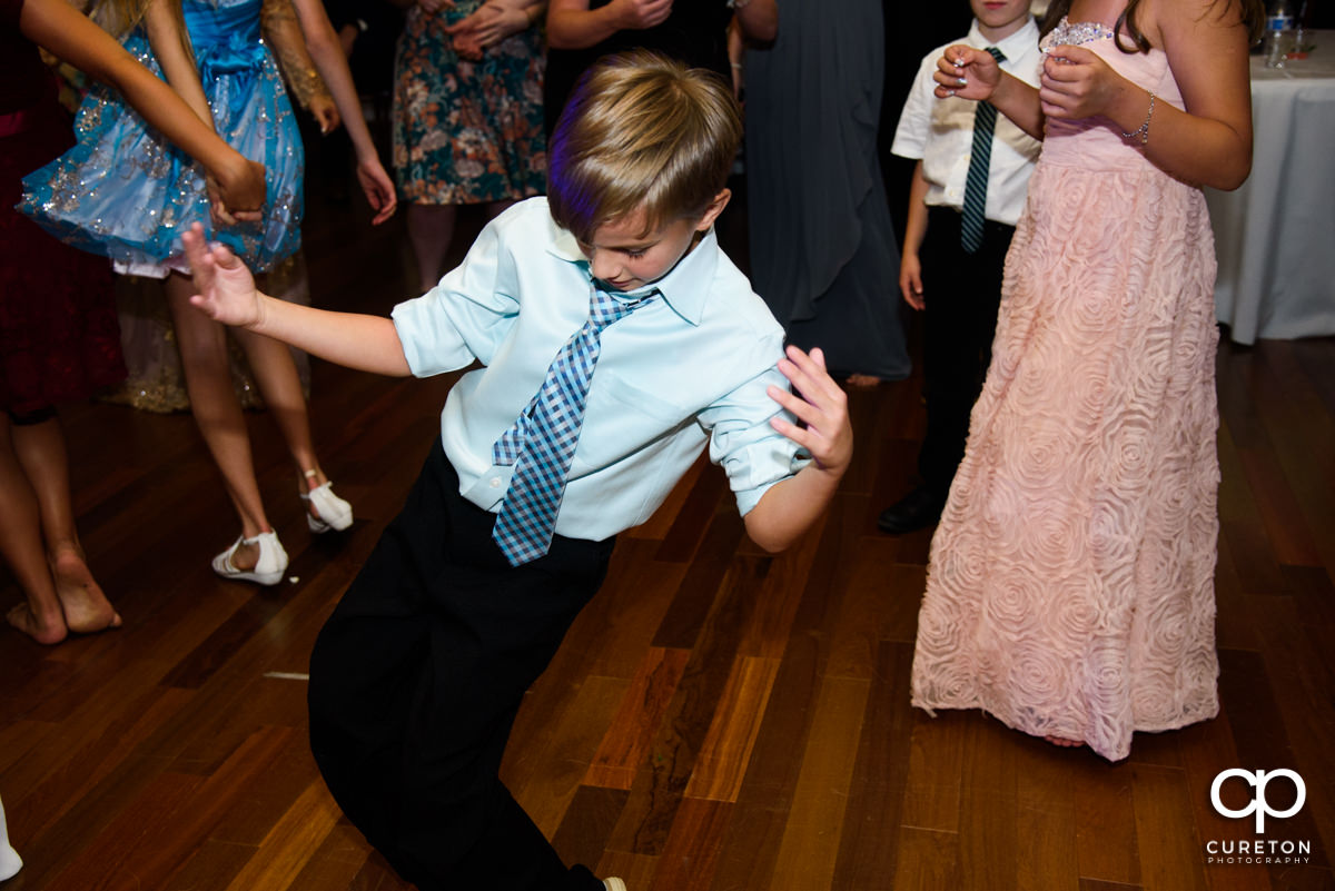 Boy dancing at the wedding reception.