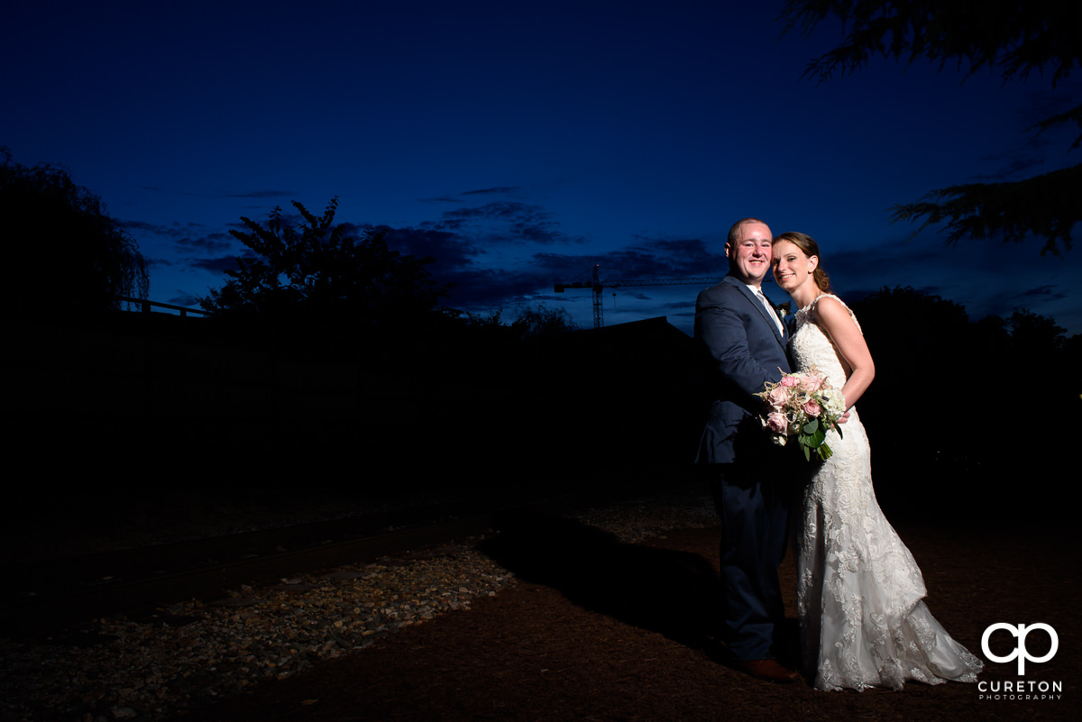 Bride and groom at blue hour outside the Old Cigar Warehouse.