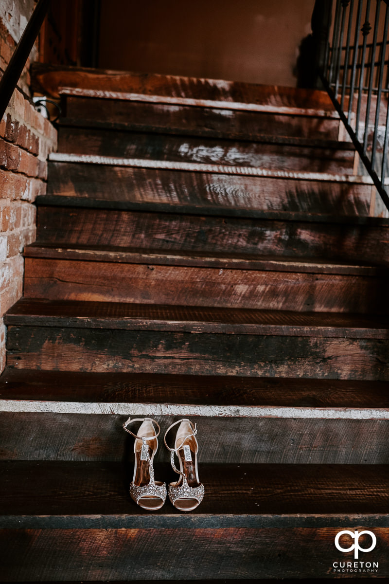 Bride's shoes on the steps.