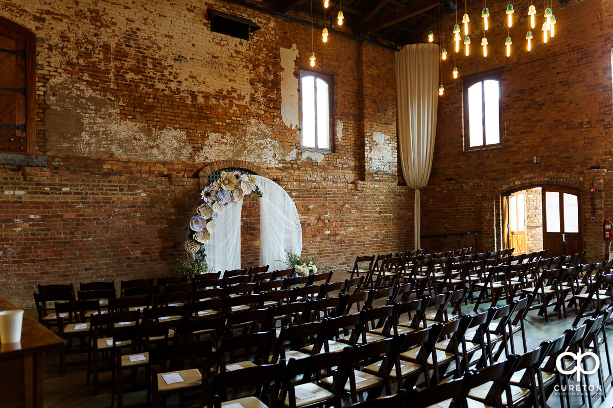 Old Cigar Warehouse setup for an indoor wedding ceremony in downtown Greenville.