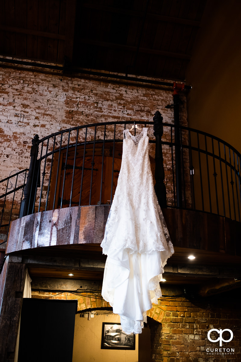 Bride's dress hanging at the Old Cigar Warehouse.