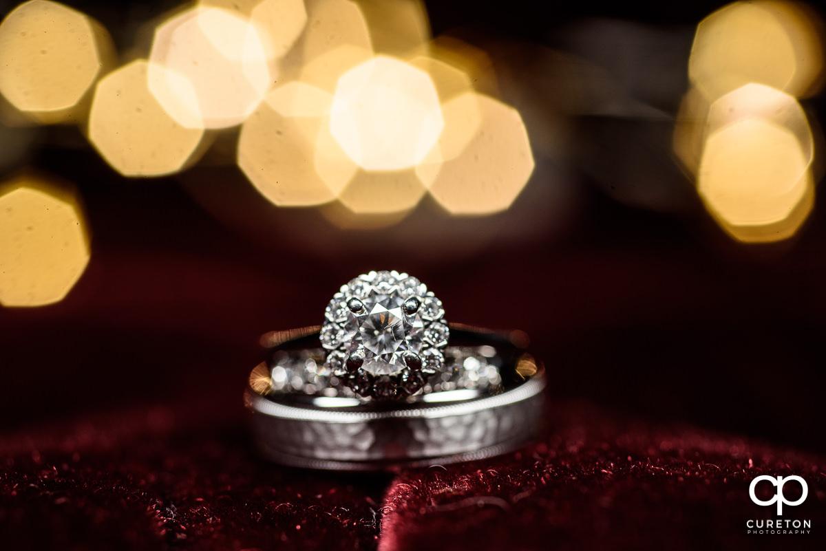 Wedding ring closeup on red velvet background.
