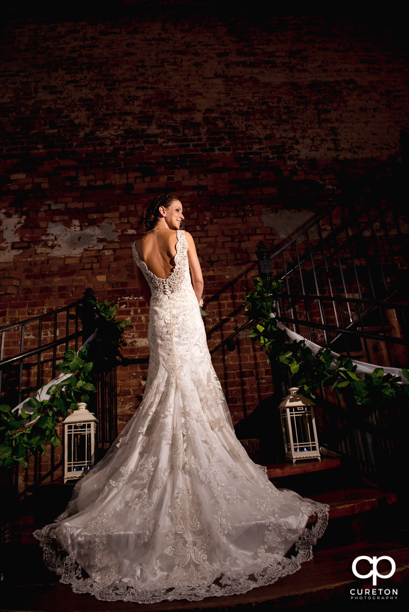 Beautiful bride standing on the steps of the Old Cigar Warehouse.
