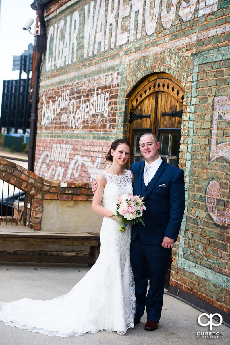 Bride and groom on the deck of the Old Cigar Warehouse in downtown Greenville,SC.