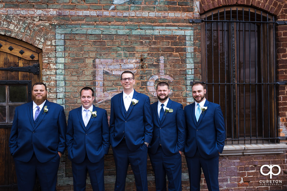 Groom and groomsmen on the deck of The Old Cigar Warehouse.