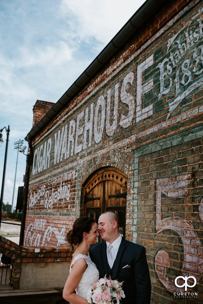 Bride and groom after their first look at The Old Cigar Warehouse.